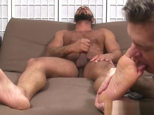Hunky Latin Damian Taylor strokes his cock while foot licked