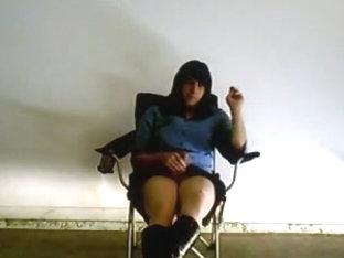 Sarah smoking in garage