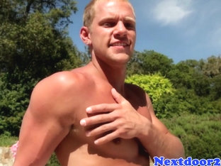 Athletic hunk poolside jerking his cock