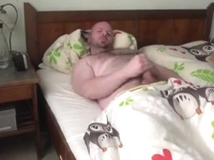 Hairy gay bear lying on the bed