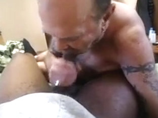 white mouth on a thick black cock