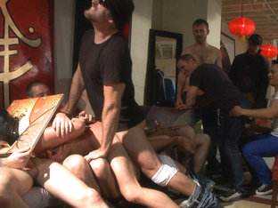 Horny crowd mercilessly gang fucks a bound hung stud against his will