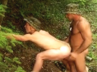 Military hunks enjoy a gay fuck in the woods