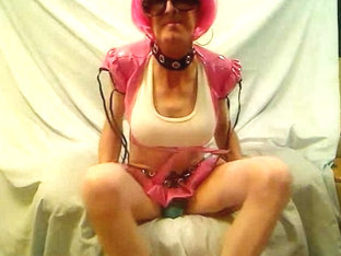 Pink haired mature crossdresser