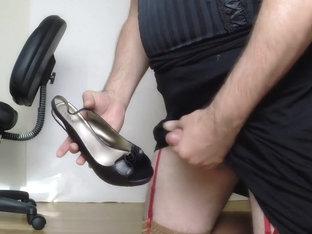 Cross dresser masturbates into high heels