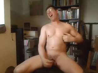 Charming BF is relaxing in a small room and filming himself on computer webcam