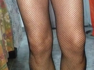 Man wearing fishnets and pink panty