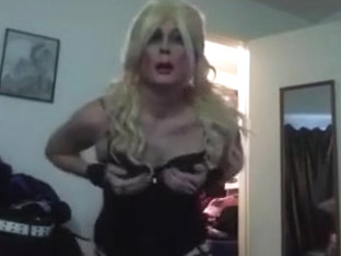Sexy Blond Tasha Dances in Black Skirt Corset Crossdresser