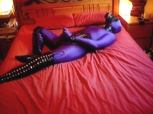 Playing in sheathed zentai, leather and rubber