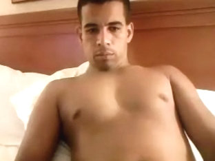 Sweet guy is jerking in a small room and filming himself on web cam