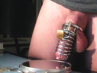 Juvenile fellow in chastity, sex-toy prostate milking, eats it all.