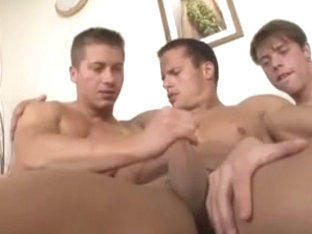Three horny gay hunks fuck each other
