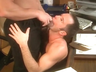 A muscular hunk tops his co-worker in the office