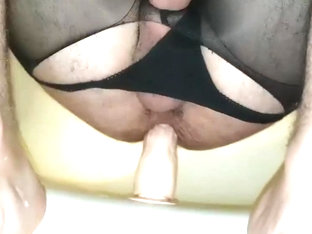Dildo play in crotchless pantyhose and panties