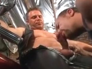 Leather biker fucks tight ass