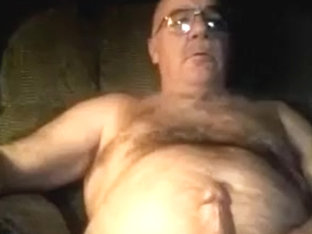 Silver furry man watching porn and cums on his belly