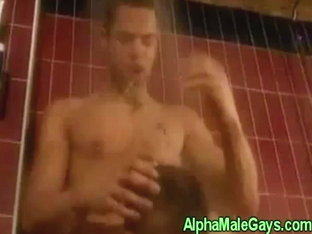 Solo gay stud jerks off in the shower