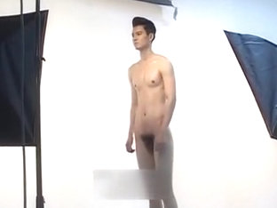 Cute naked guy posing