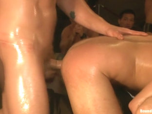 Cum slut fucked by party goers and tossed in an oil orgy
