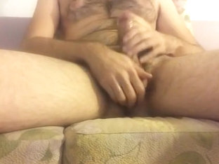 Oiled hairy cock jerking and nice big cum