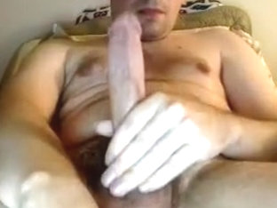 Charming male is beating off in the apartment and filming himself on webcam