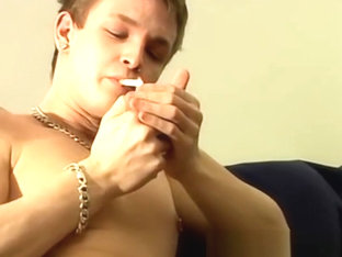 Smoking young man stroking his big dick until a warm blast