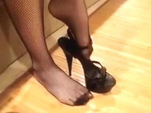 wearing heels and fishnet stockings