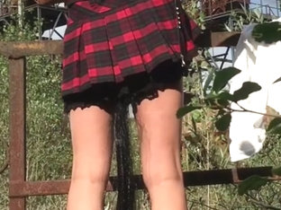 Nice ass in scotch kilt in public with ponytail