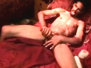 Stud massages his dick and cums