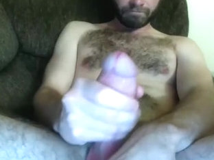 Sexy man is jerking off in a small room and memorializing himself on computer webcam