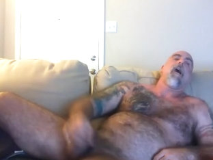 Comely dude is jerking at home and shooting himself on computer webcam