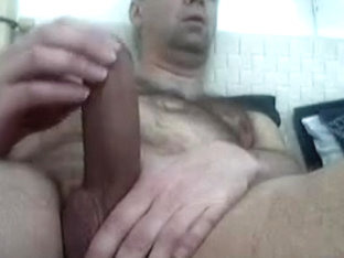 Big dicked mature man shoots a load of cum
