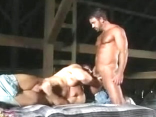 Two muscle guys kiss and blow