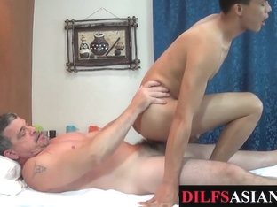 Massaging Asian twink barebacked by older guy