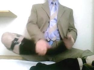 Stroking in dress, tie and socks