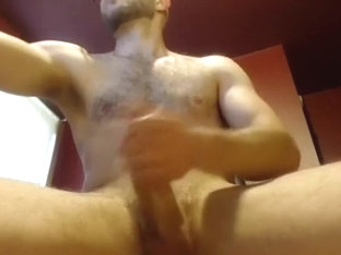 Enchanting guy is jerking off in the apartment and shooting himself on camera