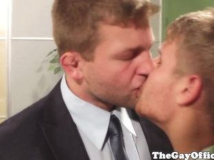 Gay office hunks take turns to suck cock