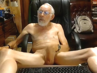 Winsome boy is having fun in a small room and filming himself on web cam