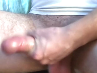 stroking my dick with condom on