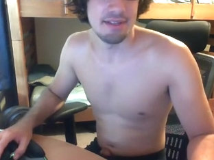 Attractive dude is beating off in a small room and filming himself on computer webcam