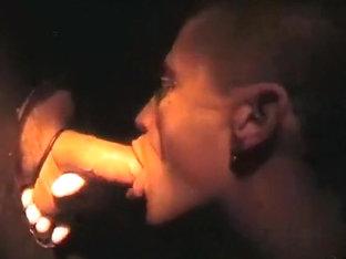 Sucking cock at a gloryhole