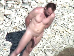 Hung uncut wank at beach