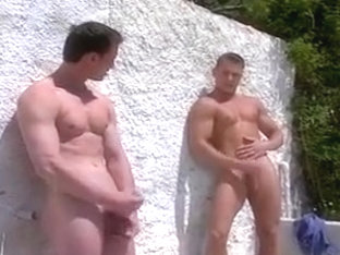 Handsome guys wank outdoors