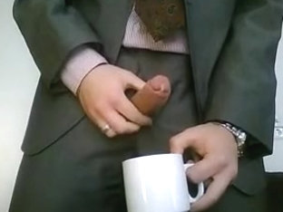 Lecherous dude in a suit jerks and cums