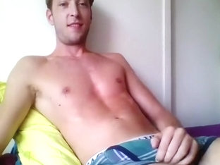 Nice-looking fag is jerking in the bedroom and filming himself on computer webcam