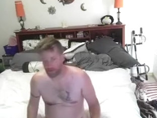 Attractive male is jerking at home and filming himself on web cam