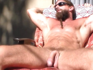jerking giant cock in the sun