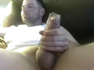 Sexy man is jerking in the apartment and shooting himself on webcam