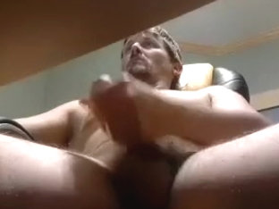 Cute poof is frigging in the guest room and shooting himself on computer webcam
