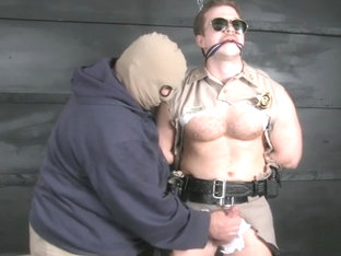 Cop bound gagged stripped and jerked off.